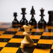Wooden chessboard with chessmen — Stock Photo
