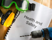 Health and safety Register with goggles, drill and earphones — Stok fotoğraf