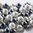 String of black and white pearls — Stock Photo #13496493