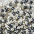 String of black and white pearls — Stock Photo #13496494