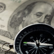 Silver black compass with money — Stockfoto #14076478
