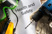 Register with goggles, drill and earphones — Stock Photo