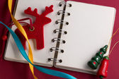 Open notebook with ribbons and reindeer — Stock Photo