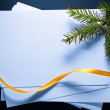 Foto de Stock  : Stack of paper cards and twig of evergreen fir