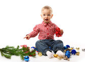 Child with fir branch and christmas decoration — Stockfoto