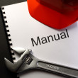 Manual with helmet and spanner — Stock Photo