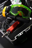 Perforator with boring bits, earphones and goggles — 图库照片
