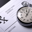 Stock Photo: Blank patient list and stopwatch
