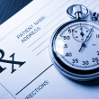 Blank patient list and stopwatch — Stockfoto