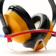 Transparent protective goggles and earphones - Stock Photo