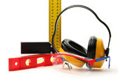 Angle ruler, balance level, goggles and earphones — Stock Photo