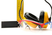 Angle ruler, goggles and earphones — Stock Photo