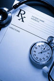 Stethoscope, stopwatch and patient list on black — Foto Stock