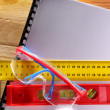 Angle ruler, balance level and goggles - Stock Photo