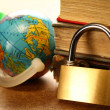Pile of old books, globe and keylock — Stock Photo