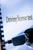 Testbook and car key — Foto Stock