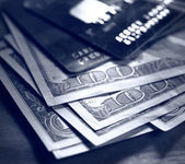 Credit cards and dollars in cash — Stock Photo