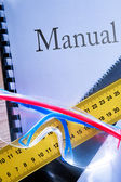 Ruler, manual, handsaw and goggles — Stock Photo
