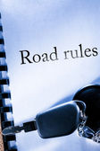 Road rules and car key — Stock Photo