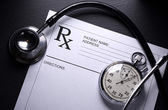 Stethoscope, stopwatch and patient list on black — Stockfoto