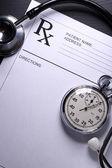 Stethoscope, stopwatch and patient list on white — Zdjęcie stockowe