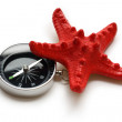 Compass and red sea star - Stock Photo