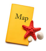 Seastar and seashells on map — Stock Photo