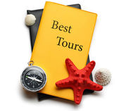Compass, seastar and seashells on best tours brochure — Stock Photo