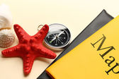 Compass, seastar and seashells on map — Stock Photo