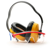 Transparent protective goggles and earphones — Stock Photo