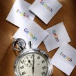 Cards with different languages and stopwatch — Stock Photo #24083977