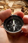 Hand holding compass on document folders background — Stock Photo