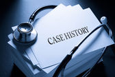 Case history and stethoscope in blue — Stock Photo