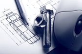 Drafting, mouse and screw bolt with nut — Stock Photo