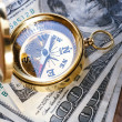 Golden vintage compass and money — Stock Photo