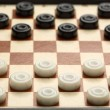 Travelling draughts on playing field - Stock Photo