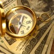 Golden vintage compass and money — Stockfoto #24894825