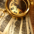Stock Photo: Golden vintage compass and money