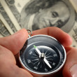 Stock Photo: Hand holding silver black compass