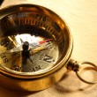Stock Photo: Vintage compass on blank yellowed paper