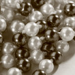 Stock Photo: String of black and white pearl in toning