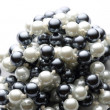 String of black and white pearls — Stock Photo #26522145