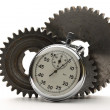 Three steel cogwheels and stopwatch — Stock Photo