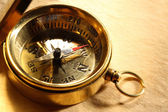 Vintage compass on blank yellowed paper — Stock Photo