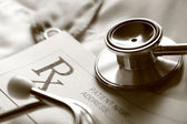Stethoscope and patient list on doctor's smock — Foto de Stock