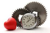 Steel cogwheels, heart and stopwatch — Stock Photo