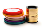 Reels of ribbon on the white background — Stock Photo