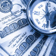 Foto Stock: Compass on one hundred dollar banknotes