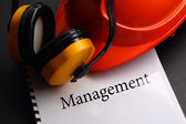Management with earphones and helmet — Stock Photo