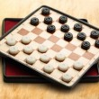 Stock Photo: Travelling draughts on aged background